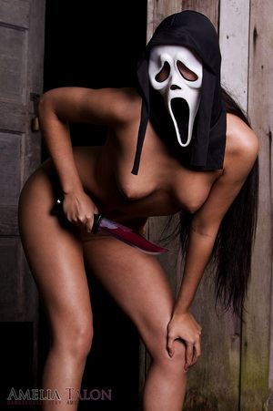 Amelia Talon looking dangerously sexy as she slowly strips naked wearing her scream mask